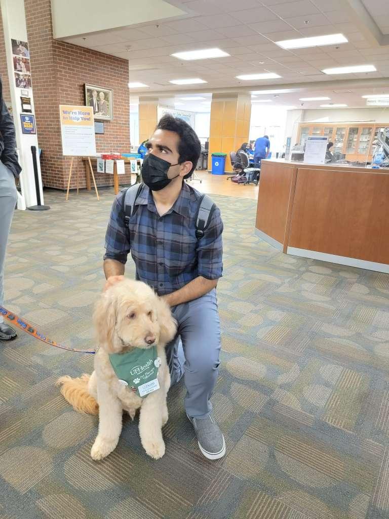 Nico Manhas and Beau the Therapy Dog